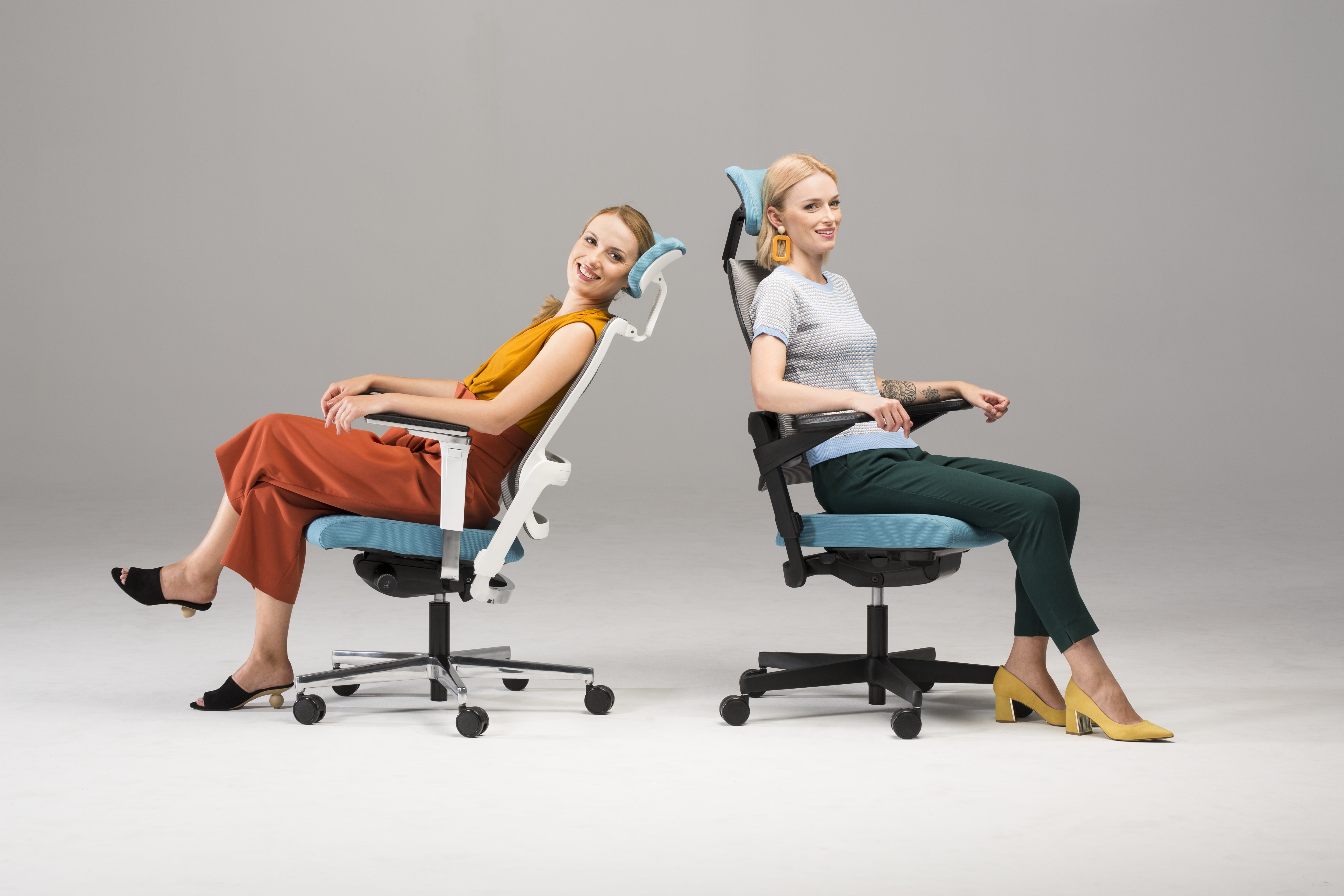 to girls seating on Xilium chairs